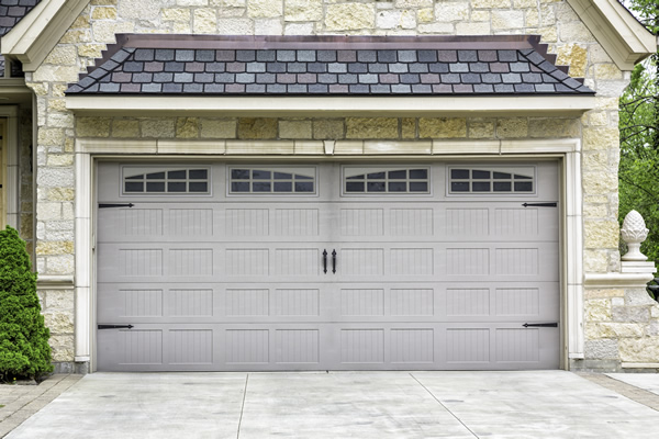 Two car garage with new vinyl carriage house style garage door