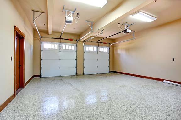 New garage doors installed with roller door showing horizontal tracks
